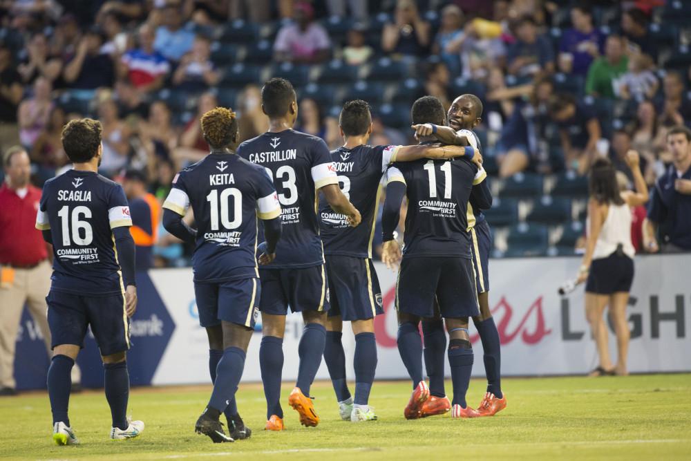 Jacksonville players approach Akeil Barrett after his goal. (Photo: Jacksonville Armada FC)